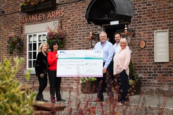 The Alvanley team presenting a cheque to When you wish upon a star