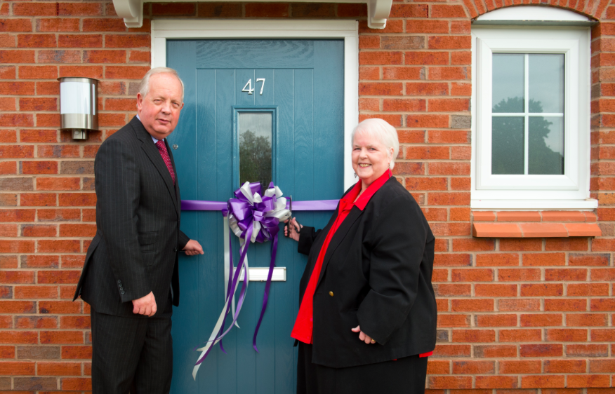 Shared ownership in Brinnington Picture: The official ribbon cutting by Philip Whitehead, Regional Regeneration Director for Countryside, and Councillor Sheila Bailey, cabinet member for communities & housing at Stockport Council.